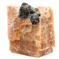 Black mica crystals on on orange calcite block