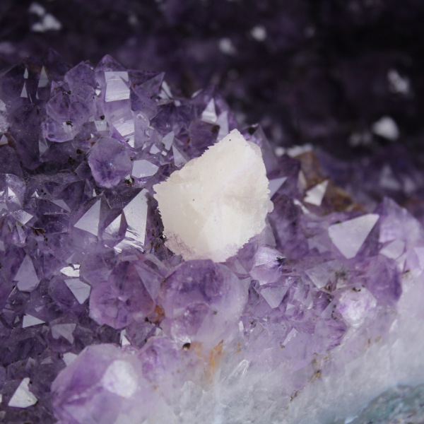 Amethyst geode with calcite crystal